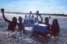 Houseterns working hard at an epic beach party on the sandbar in front of Station 28 1/2 on Sullivan's Island.